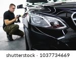car detailing   worker with... | Shutterstock . vector #1037734669