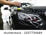 car detailing   worker with... | Shutterstock . vector #1037734684