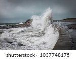 waves and storm surge crash... | Shutterstock . vector #1037748175