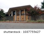 exterior of a large abandoned... | Shutterstock . vector #1037755627