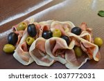 salad of cold cuts with olive ... | Shutterstock . vector #1037772031