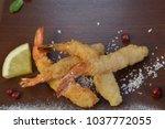 shrimp fried in breadcrumbs.... | Shutterstock . vector #1037772055