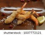 shrimp fried in breadcrumbs.... | Shutterstock . vector #1037772121