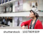 the asian woman posing at the... | Shutterstock . vector #1037809309