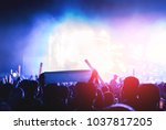 silhouette crowd of concert... | Shutterstock . vector #1037817205