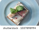 Stock photo a traditional sandwich with a young herring on black bread cream cheese herring fillets a hard 1037898994