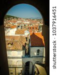 Small photo of Old city buildings with orange roofs aerial view through arch of venetian Saint Domnius bell tower, Split, Dalmatia, Croatia