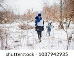 winter walk  mother with two... | Shutterstock . vector #1037942935