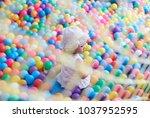 asian little girl play with...   Shutterstock . vector #1037952595