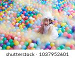 asian little girl play with...   Shutterstock . vector #1037952601