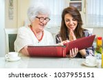 cheerful grandmother and...   Shutterstock . vector #1037955151