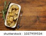 preserved grill artichokes in... | Shutterstock . vector #1037959534