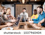 young coworkers dressed... | Shutterstock . vector #1037960404
