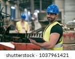 portrait of worker man with... | Shutterstock . vector #1037961421