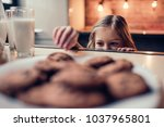 little cute girl on kitchen is... | Shutterstock . vector #1037965801
