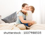 little son is hugging and... | Shutterstock . vector #1037988535