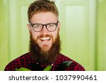 close up potrait of beard... | Shutterstock . vector #1037990461