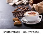 cup of cappuccino coffee on... | Shutterstock . vector #1037995351
