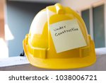 yellow safety hardhat with text ... | Shutterstock . vector #1038006721