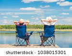 man and woman relax on a pier...   Shutterstock . vector #1038015301