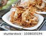 crispy fried crabs at street... | Shutterstock . vector #1038035194