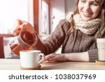 woman pours tea from a teapot... | Shutterstock . vector #1038037969