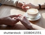 couple drinking coffee at cafe... | Shutterstock . vector #1038041551