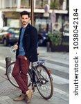 attractive man in the street... | Shutterstock . vector #1038042184