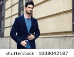 attractive man in the street... | Shutterstock . vector #1038042187