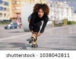 young fit black woman on roller ... | Shutterstock . vector #1038042811