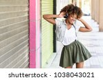 young attractive black woman in ... | Shutterstock . vector #1038043021