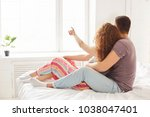 back view of affectionate... | Shutterstock . vector #1038047401