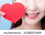 Small photo of woman wear brace and take heart on the blue background