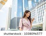 young asian working woman going ... | Shutterstock . vector #1038096577