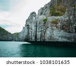 trees and stones in the emerald ... | Shutterstock . vector #1038101635