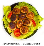 meat cutlets on lettuce leaves... | Shutterstock . vector #1038104455