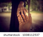 male and female hands touched... | Shutterstock . vector #1038112537