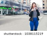 youn girl walking on the street. | Shutterstock . vector #1038115219