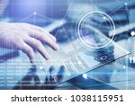 man working on a project using... | Shutterstock . vector #1038115951