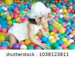 little asian girl having fun at ...   Shutterstock . vector #1038123811