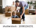 father helping cute little son... | Shutterstock . vector #1038126151