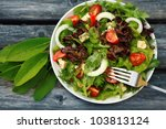 Fresh Salad With Tomatoes And...