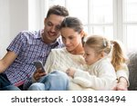 parents with daughter watching... | Shutterstock . vector #1038143494