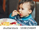 child eating fries with your... | Shutterstock . vector #1038154849