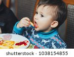 child eating fries with your... | Shutterstock . vector #1038154855