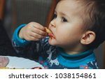 child eating fries with your... | Shutterstock . vector #1038154861