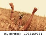 girl holding flowers and lying... | Shutterstock . vector #1038169381