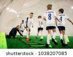football team of adorable boys... | Shutterstock . vector #1038207085