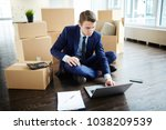 busy young manager in suit...   Shutterstock . vector #1038209539