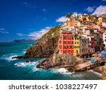View of the colorful houses along the coastline of Cinque Terre area in Riomaggiore - stock photo